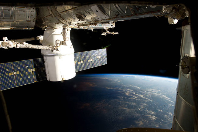 dragon berthed station over earth