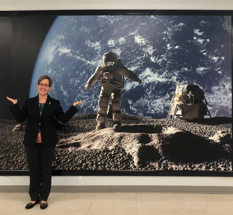 Laurie Orth in front of Space Mural