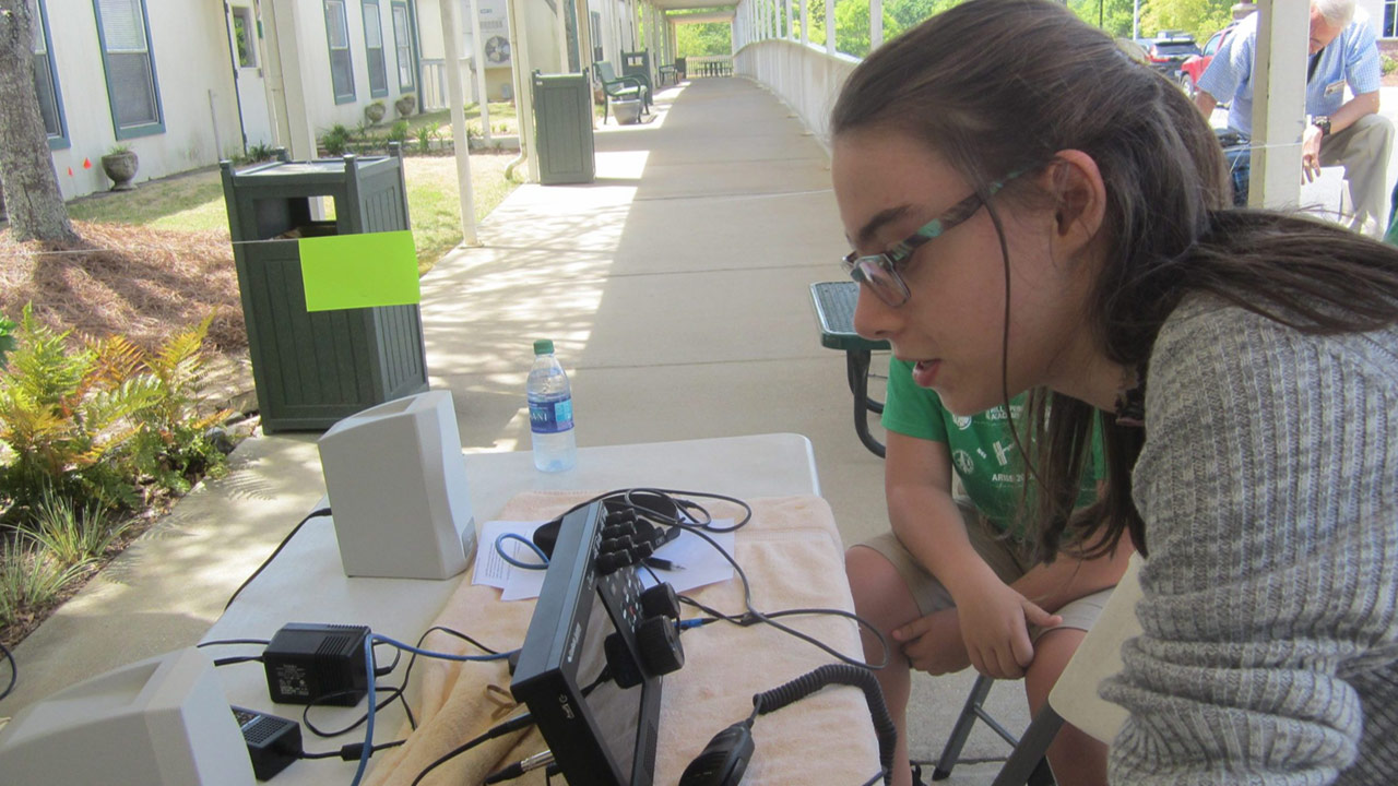 Lydia at a scienc day ham radio exhibit in 2018 IMG 5915