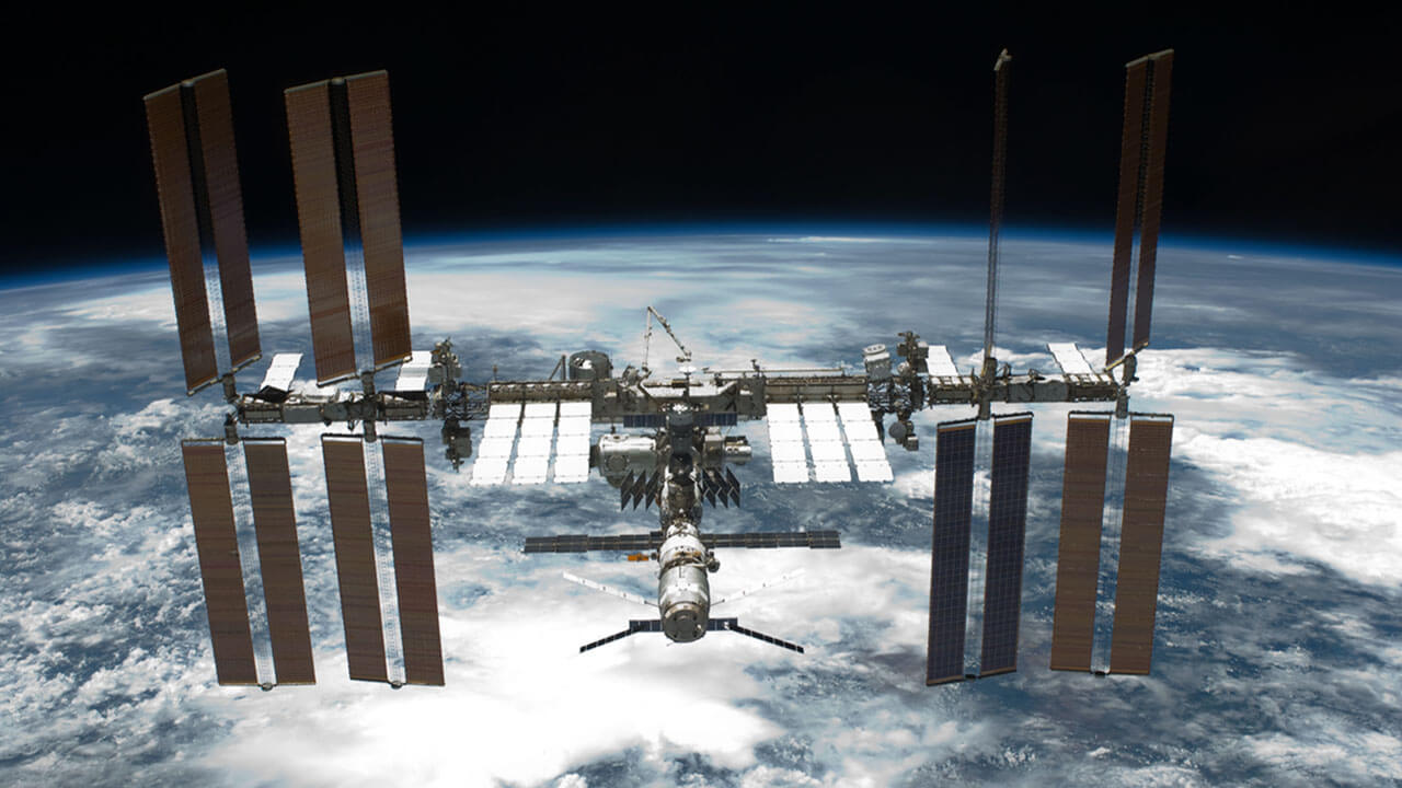 iss over cloudy earth 1