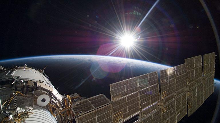 sun over earth nasa iss768