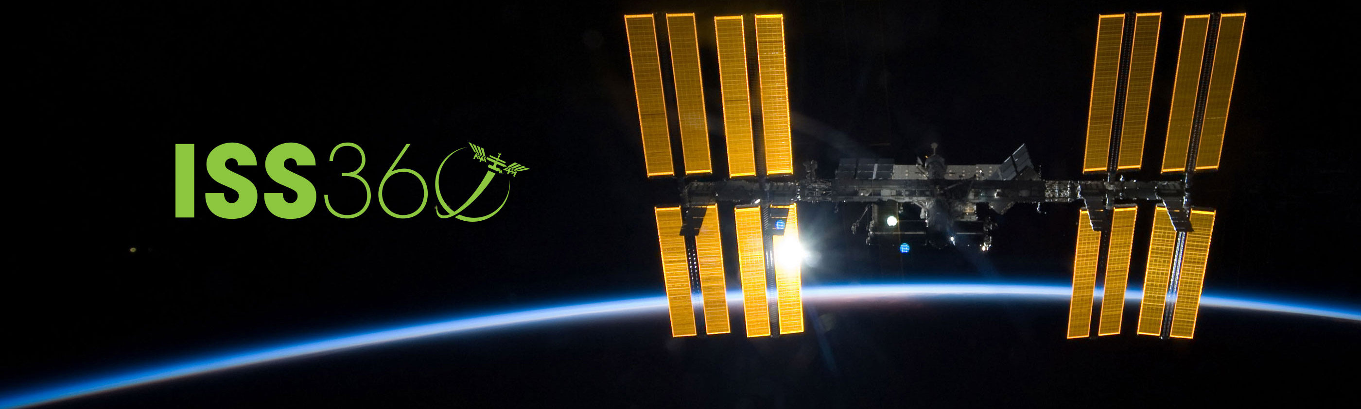 iss illumnated by sun over earth horizon iss360 banner green