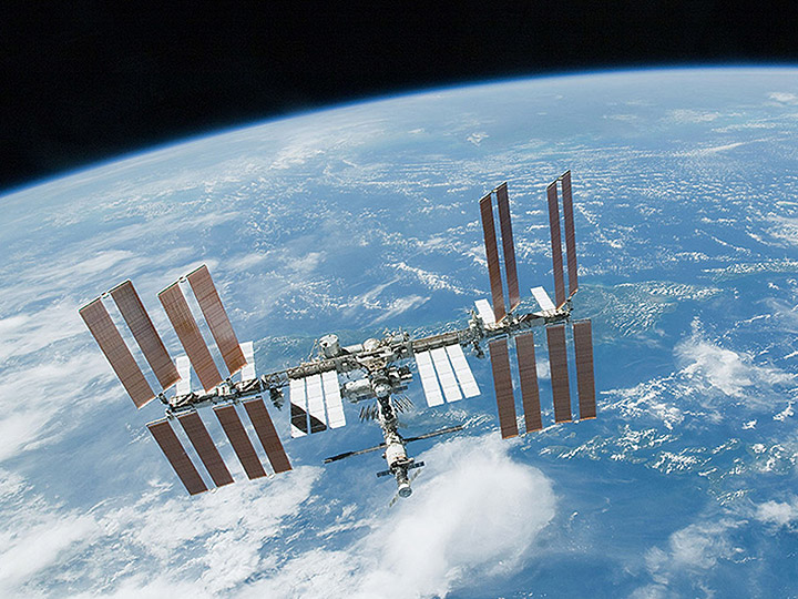 iss over blue white earth