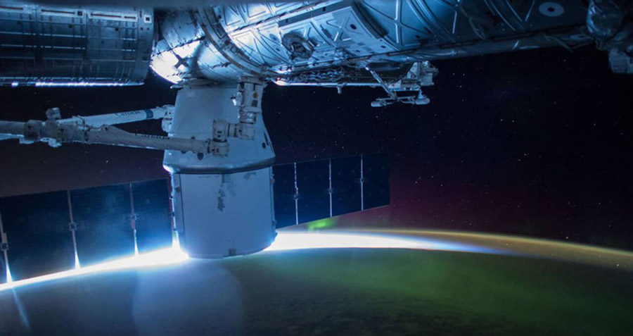 spacex dragon over earth sunglow